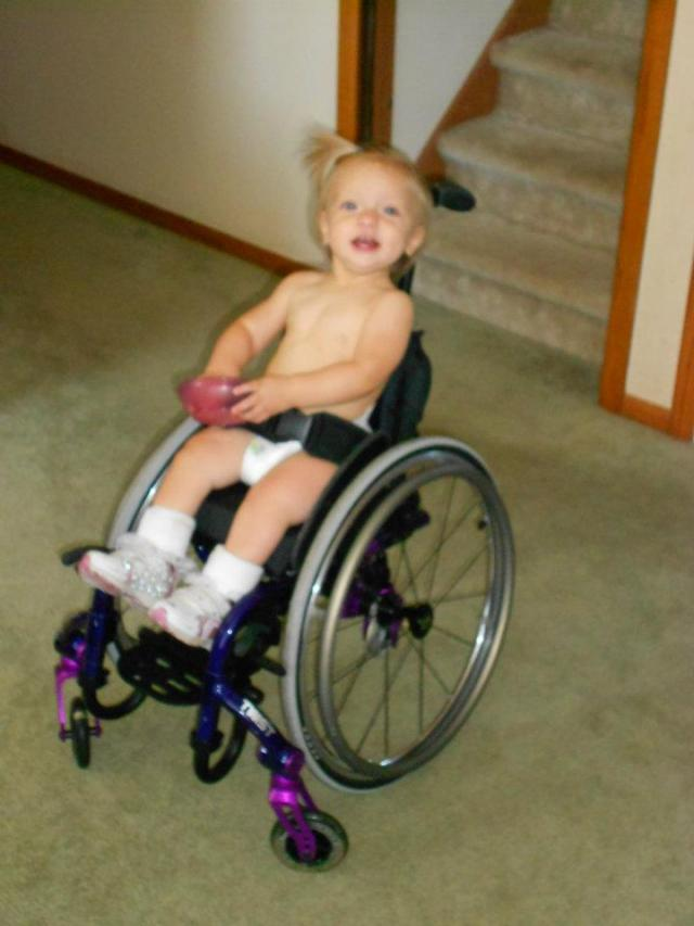This is an especially fantastic picture for me. :) Peanut was really excited to try out demo wheelchairs.